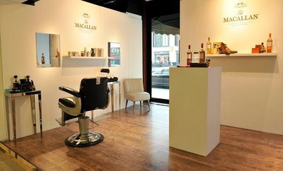 You can drink whisky while a Macallan warehouseman cuts your hair using a flogger and a bung extractor.